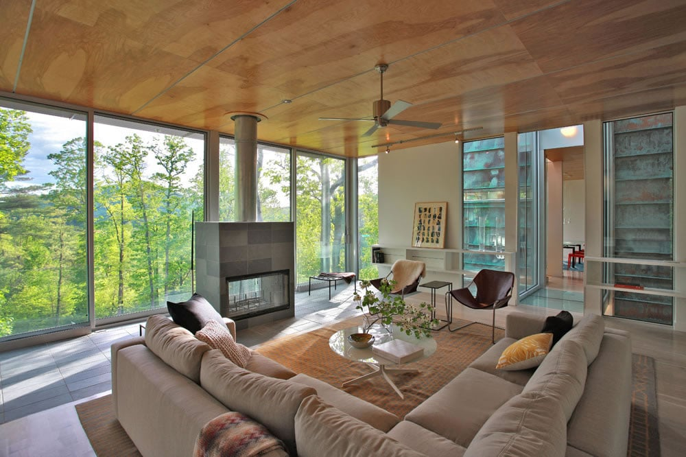 The living room is deliberately placed on the second floor so that it receives increased amounts of natural light and overlooks the surrounding woods and neighboring mountains.