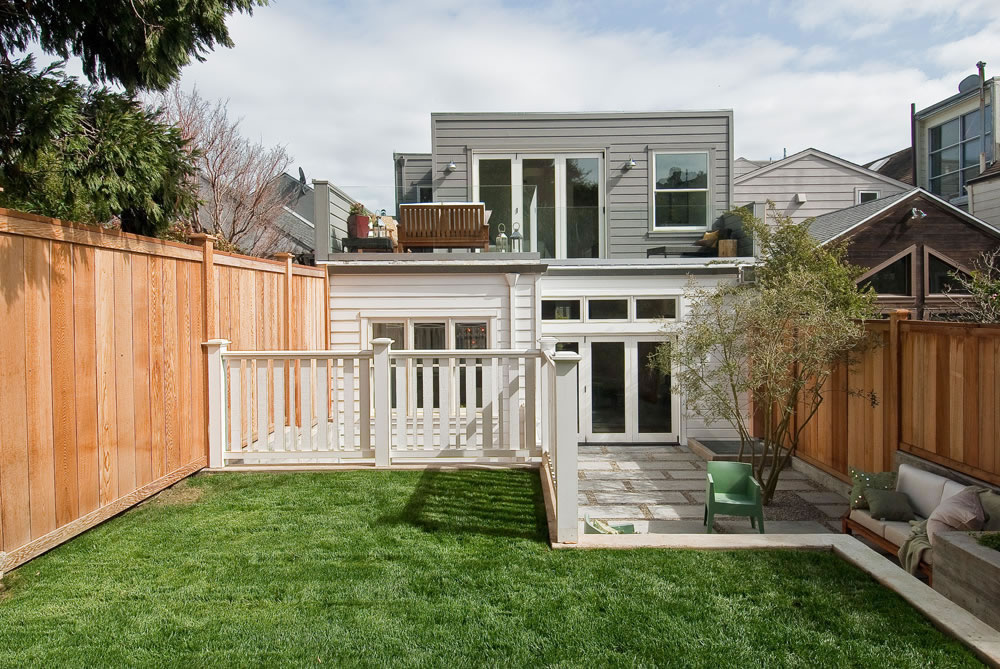 Neighboring homes, which sit next to each other with almost no space in between, forced the builder to make a number of compromises, including foregoing an additional third bedroom.